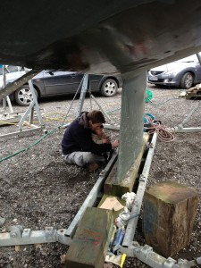 Thomas helping remove barnacle feet before burnishing