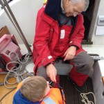 Granddad checking the safety gear