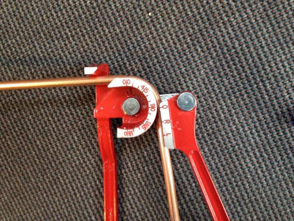 Pipe bender post bend
