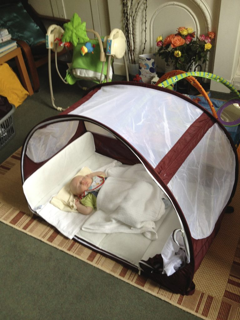 Trying the cot out in our living room