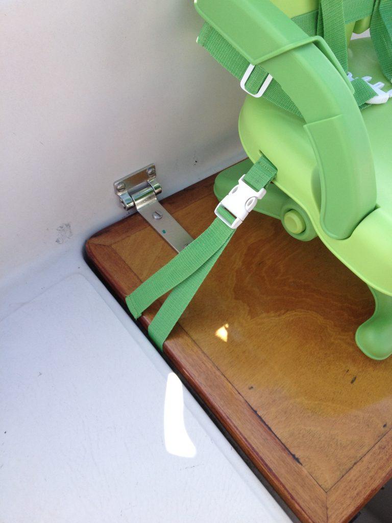 Feeding chair strapped through aft locker