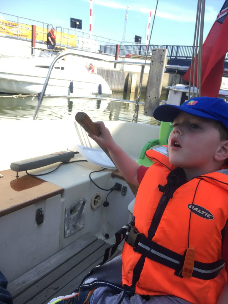 Thomas on the helm in Chatham lock