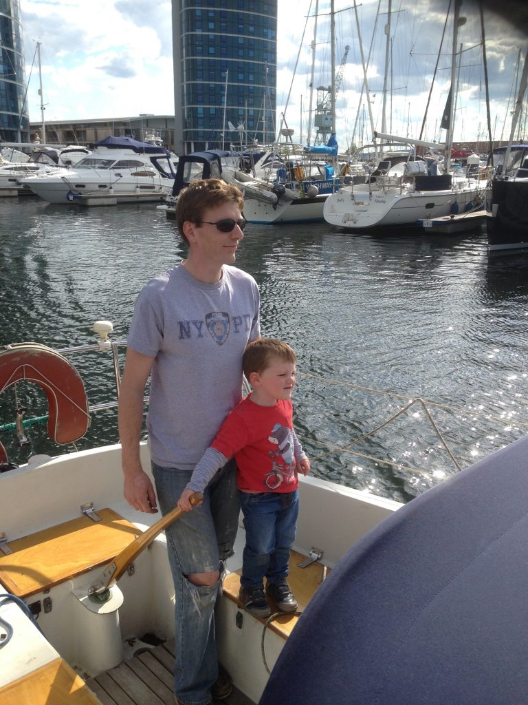 Thomas on the helm in Chatham marina