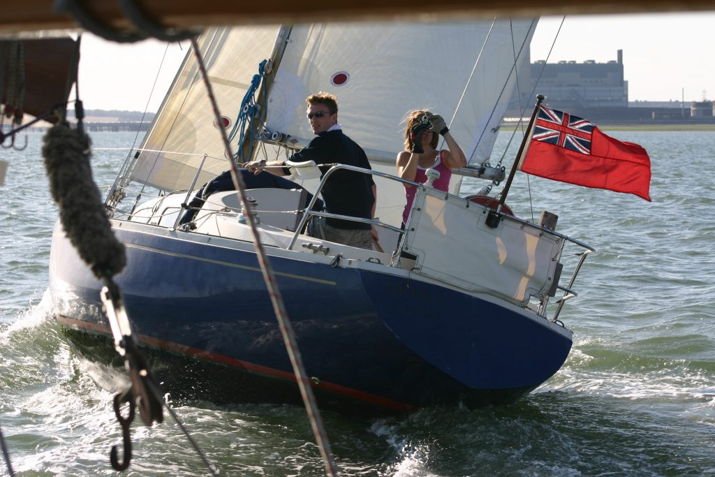 Sailing Triola pre kiddiwinks, being chased by my late father, Colin Ryans, gaff cutter Wanda